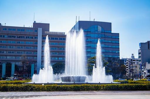The fountain of Peace Memorial Park and the cityscape of Hiroshima