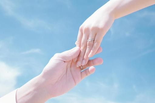 Hands of a young newlywed couple