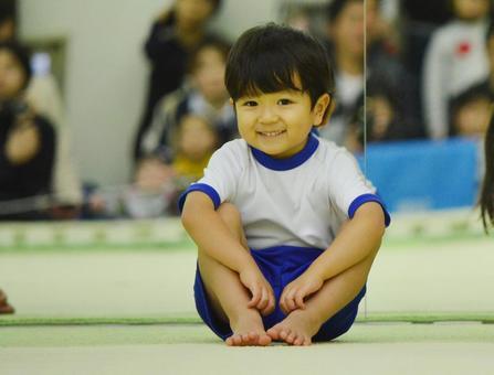 Child gymnastics sitting