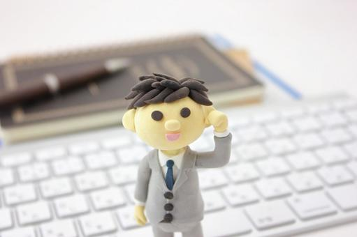 Businessman standing on the keyboard 3