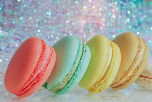 Macaroons lined up in a glittering background