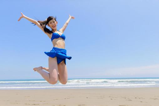 Woman jumping on the beach 2