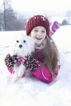 Girls and dogs lying on the snow 2