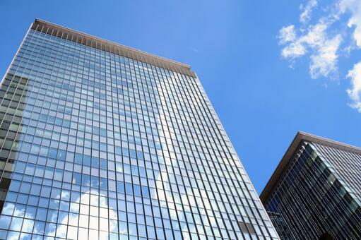 Building reflecting in the blue sky