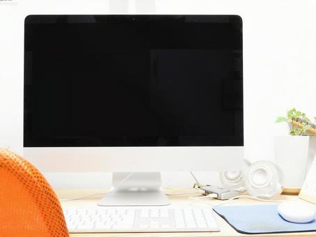Desktop computer and foliage plant