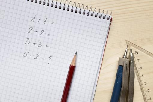 Pencil and compass, triangle ruler and note