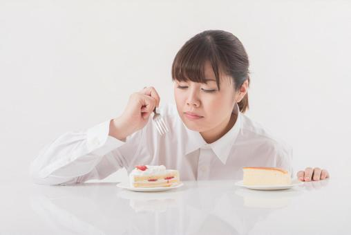A woman eating a cake 1