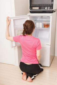 A woman looking into the refrigerator 3