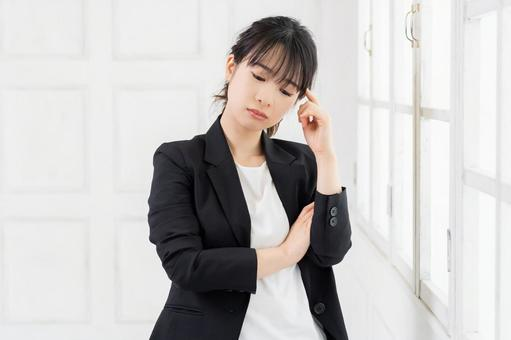 Young woman making a thinking gesture