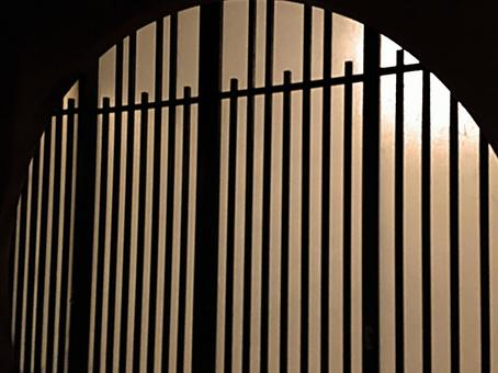 Image of a dark round window shoji