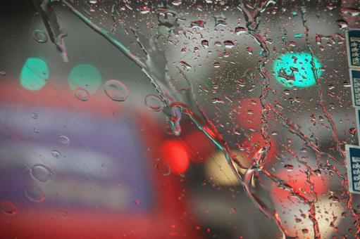 Car window glass on a rainy day