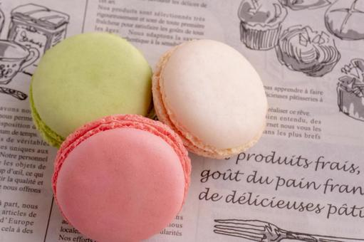 Macaroons placed on French wrapping paper