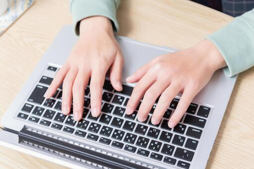 Hands of a woman using a laptop