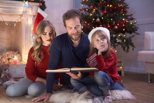 A family reading a book