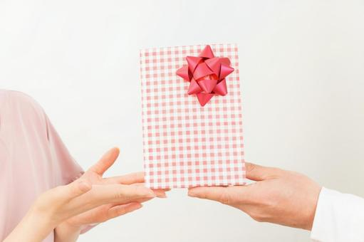 A woman receiving a gift