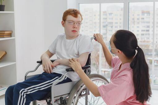 Physiotherapist and boy having a conversation