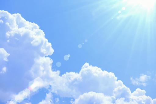 Midsummer blue sky, white clouds and shining sun
