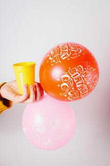 Birthday celebration balloons and cups