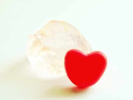 Natural stone with red heart and rose quartz