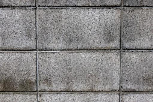Cross pattern on the surface of the gray block wall