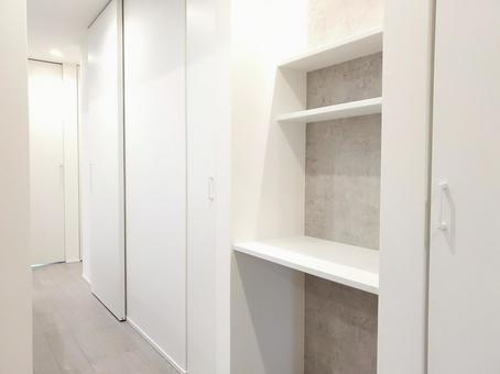 Aisle and bag storage in a newly built house without a corridor