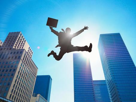 A businessman bouncing off in the office town