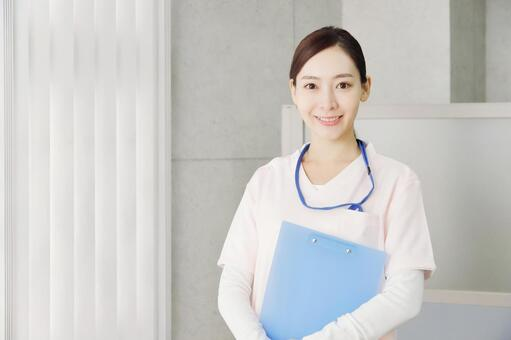 Image of a smiling woman working at a medical institution / nursing facility