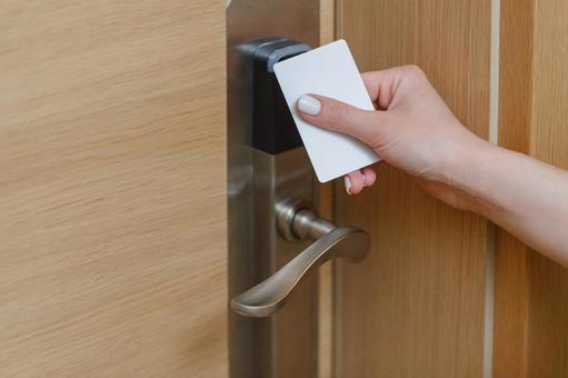 Hotel service Hand holding the card key over the door