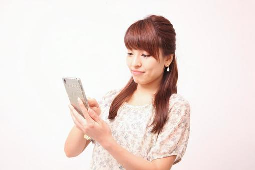 A woman operating a smartphone 1