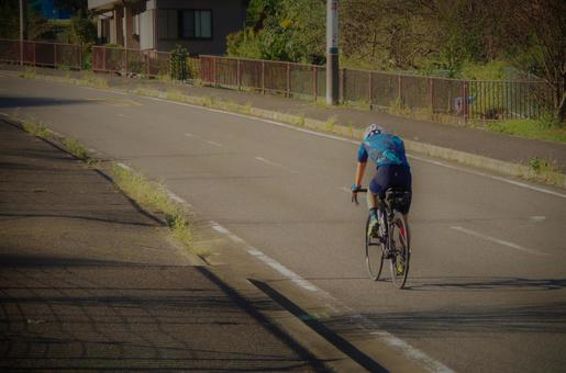 Road bike climbing a hill