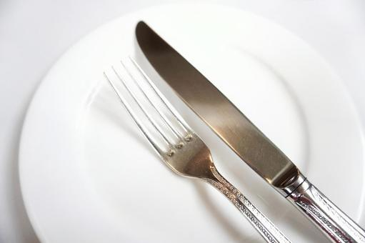 White plate, knife and fork