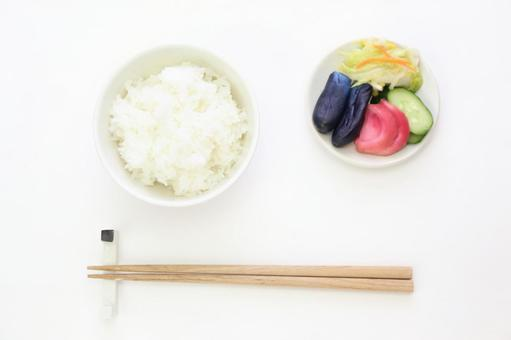 White rice cooked and pickles