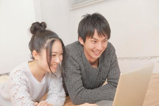 Couples using a personal computer 6