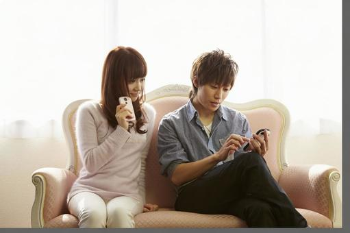 A couple looking at a cell phone 14