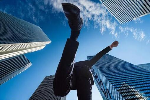 Japanese male businessman jumping in the city