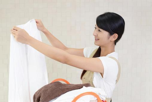 Smile housewife with laundry