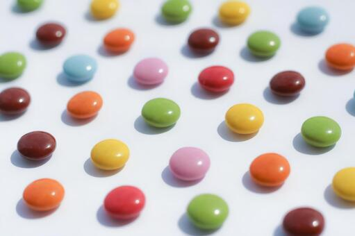 Colorfully lined sugar-coated chocolate