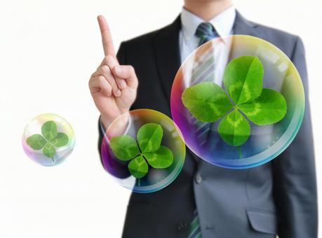 Men pointing to environmental business point-white background and four leaf clover and soap bubbles
