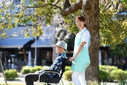 Caregiver pushing a wheelchair