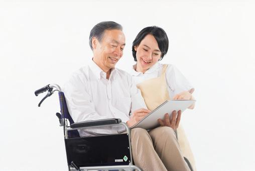 Men with wheelchairs and caregivers 8