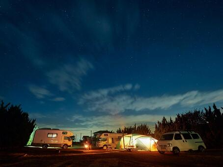 Image of auto camp under the starry sky in winter