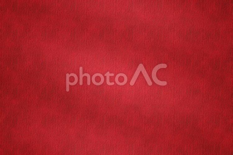 背景素材 ー ライトに照らされた水シボ牛革/赤・レッドの写真