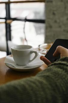 Hand and coffee using smartphone 2