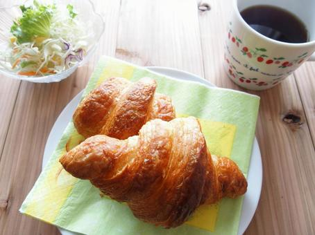 Croissant and salad and coffee