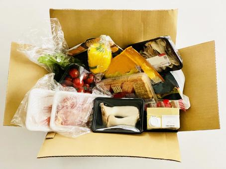 A lot of food in a cardboard box _ bird's-eye view