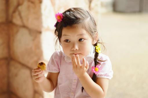 Girl eating macaroons