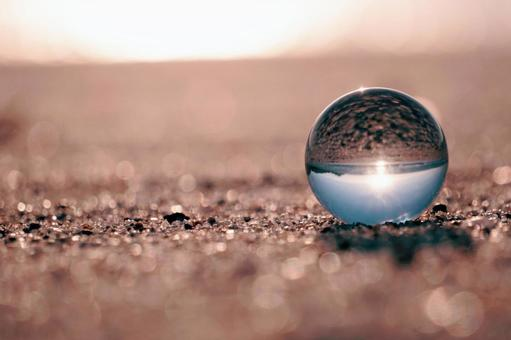 Crystal ball on the sand