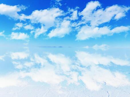 Uyuni salt lake in the rainy season in Bolivia, Central and South America-Blue sky and clouds reflected