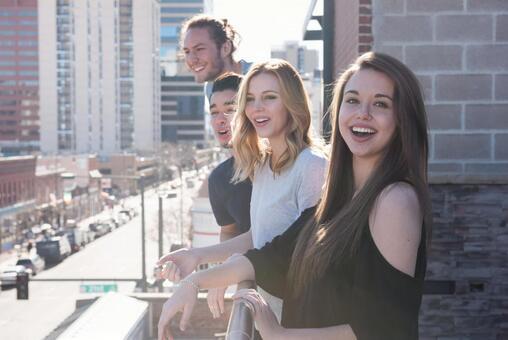 4 women and men watching the scene 4