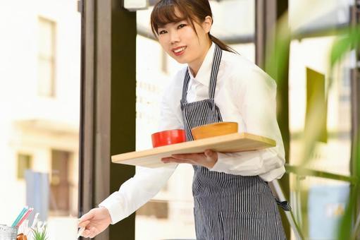 Female clerk serving meals